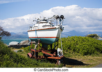 Boat on a trailer next to beautiful Welsh Landscape.