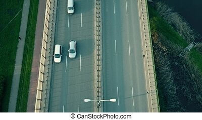 Aerial tilt shot of highway and guyed car bridge in Warsaw....