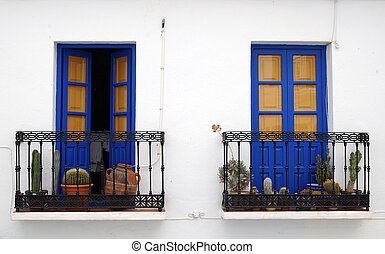 Blue balconies in Andalusia - Blue balconies on a street in...
