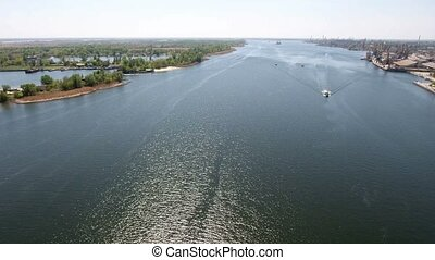 Aerial shot of the endless streams of the Dnipro river with...