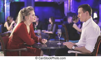 Girl and man on date in restaurant