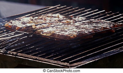 Closeup Person Roasts Meat on Fire on Barbecue Grid -...