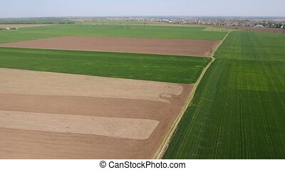 Aerial shot of a palette of country fields in Eastern Europe...