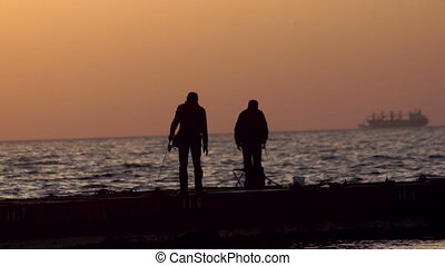 Fisherman sea sunrise - Fisherman fishing on the place of...