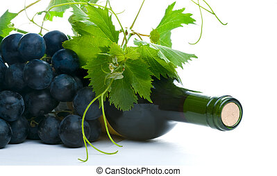 bottle of red wine with grapeleaf and grape