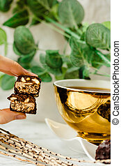 Homemade raw chocolate candy. Piece of Snickers bars in...
