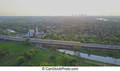 Aerial panoramic shot of Warsaw skyline and guyed bridge in...