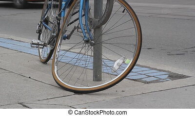 Bent bicycle. - A vandalized bicycle with bent front wheel.