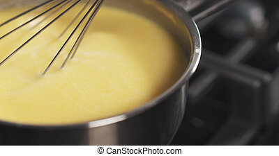 preparing bechamel sauce milk mix, 4k photo
