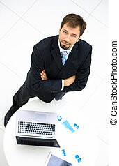 Portrait of a handsome elderly business man standing isolated on