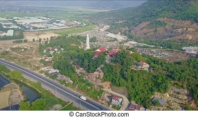 Aerial View Motion Away from Buddha Statue along Road -...