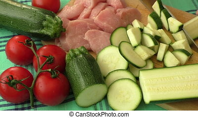 Raw fresh meat on cutting board and fresh vegetables