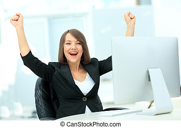 Exited, successful business woman looking at camera -...