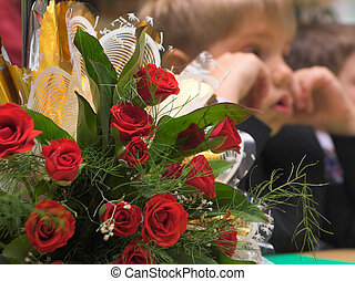 preschool  - schoolboy with bunch of red rose