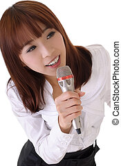 singing - Attractive business woman singing with microphone,...