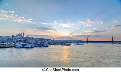 Passenger Ferries in the Golden Horn at sunset timelapse, Istanbul skyline, Turkey