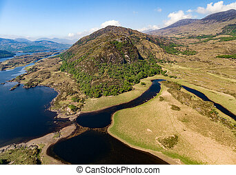 Aerial view Killarney National Park on the Ring of Kerry, County Kerry, Ireland. Beautiful scenic aerial of a natural irish countryside landscape.