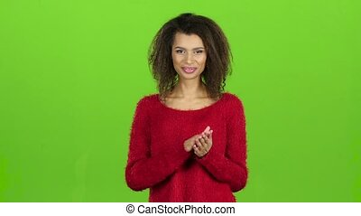 Afro american woman smiles and clapping, green screen. Slow...