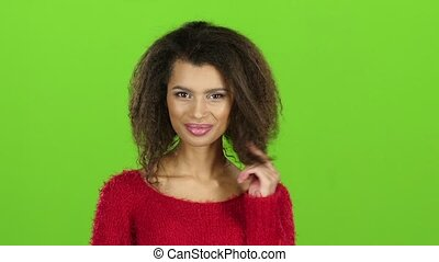 Smiling mulatto woman seduces you, green screen background....