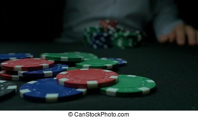 Close-Up of Man Throwing a Poker Chips in slow motion....