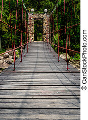 Small bridge in park - Wooden with rope Foot bridge in the...