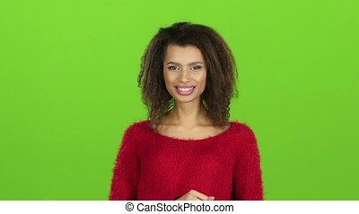 Woman showing two thumbs up, gesture. Slow motion, green screen
