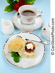 Tea And Scones - Fresh baked scones with jam and cream with...