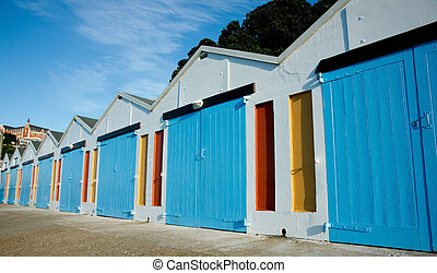 Quaint boat shed - Boat sheds, lined up along the harbor,...
