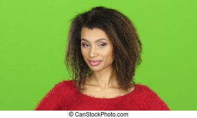 Afro american woman flirts and winks at eye, green screen -...
