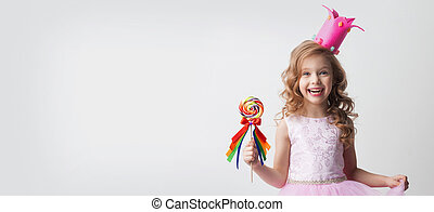Candy princess with lollipop - Small princess girl in crown...
