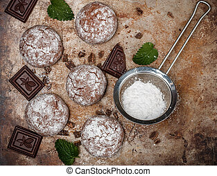 Chocolate Crinkles. Cooking chocolate cookies with powdered...