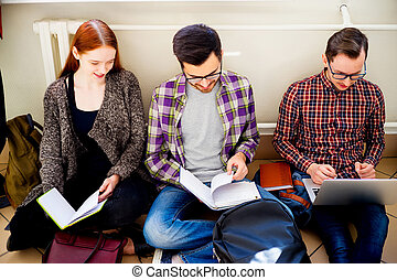 Group of college students - A group of college students on...