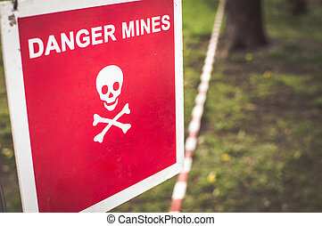 Warning sign - Danger mines on a forest.