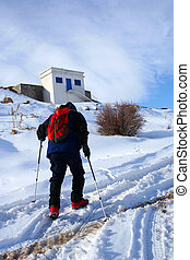 mountaineer - a montaineer walking alone in mountain
