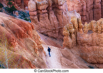 Hiker on trail in Bryce Canyon National Park, Utah