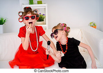 two fashion-mongers children - Two funny little girls with...