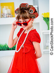 pretty red dress - Portrait of a funny little girl with...