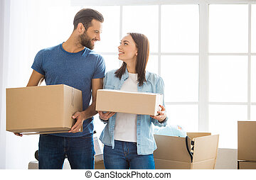 Young couple moving to a new apartment together relocation -...