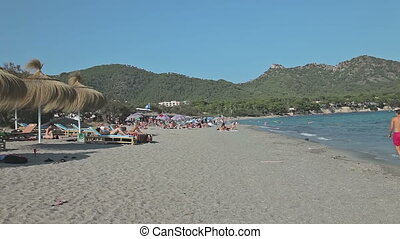 People bathe and rest on the beach. Spanish beaches in Mallorca