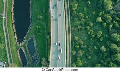 Aerial tilt shot of a modern highway the evening. 4K video -...