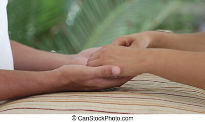 Relaxed holding hands on pillow - Shot of Relaxed holding...