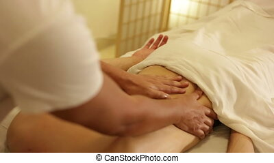 Man with back pain having a massage - Shot of Man with back...