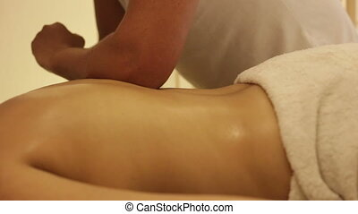Masseuse uses his elbow during massage - Shot of Masseuse...