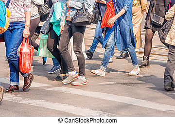 road crossing with women, pedestrian feet on sunny spring...