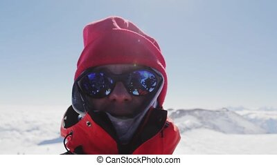 A man makes a selfie on top of Mount Elbrus in a state of...