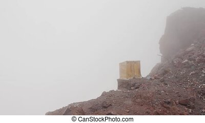 Toilet on the edge of a cliff - Slope of the mountains of...