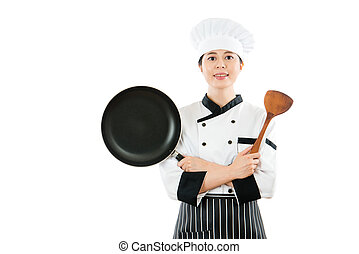 professional chef showing pan and wooden spatula -...