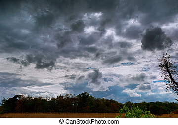 Thundercloud with possible formation of a tornado with a...
