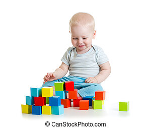 Kid building from toy blocks. Isolated on white background