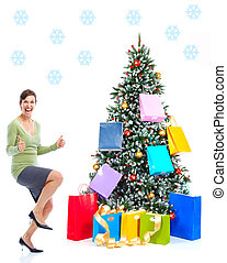Christmass woman - Smiling happy shopping woman near a...